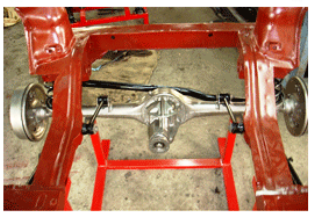 Model No. XS-63 CUT SECTION MODEL OF COMPELETE COIL SPRING TYPE REAR SUSPENSION SYSTEM